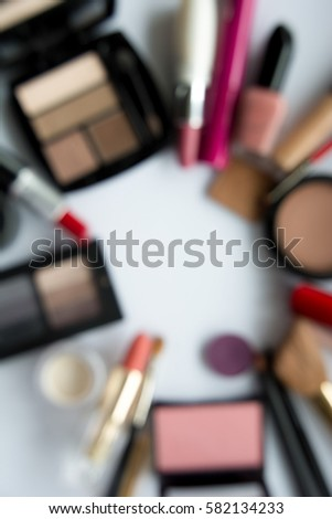 Decorative cosmetics blurred with white background