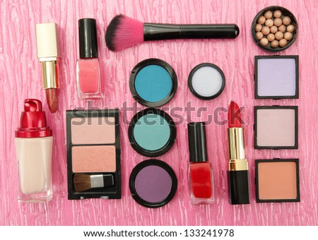 Decorative cosmetics on pink background - stock photo