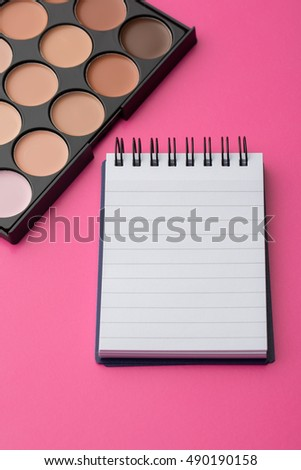 decorative cosmetics with notebook