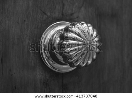 Decorative door knob. Black and white photography. - stock photo