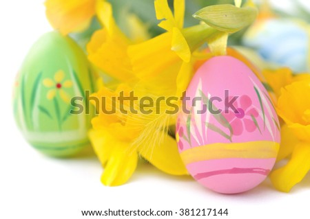 decorative Easter eggs with daffodils on white background