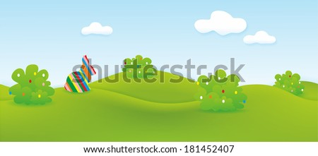 decorative easter landscape with easter bunny, hills, easter eggs and meadow