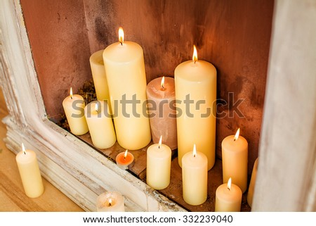 decorative fireplace with candles - stock photo