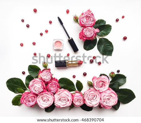 decorative flat lay composition with cosmetics and flowers top view on white background - Decorative Flowers