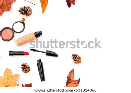 Decorative flat lay composition with cosmetics, woman accessories, decorated with autumn leaves . Flat lay, top view on white background, fashion still-life