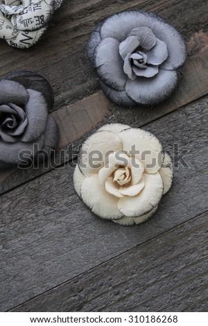 decorative flower embellishments on a wooden background
