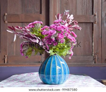 decorative flower near the old window - stock photo