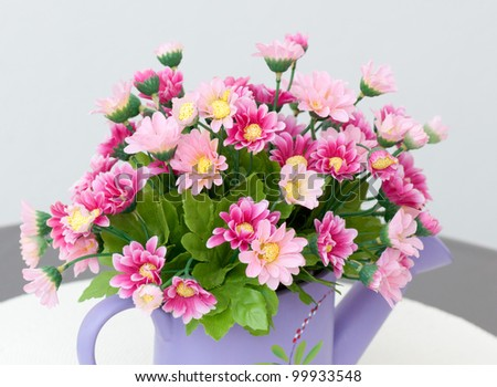 decorative flowers on table on table - stock photo