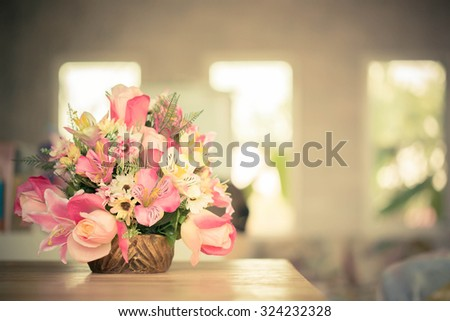 decorative flowers on the table , warm tone color use for background - stock photo