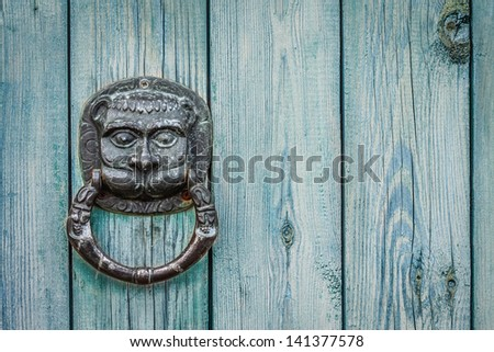 Decorative gilded lion head door knob. Lion head, brass door knocker - stock photo