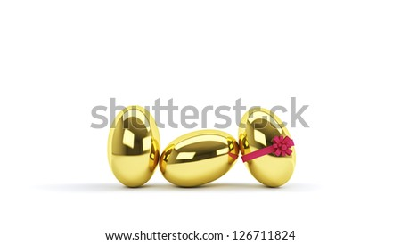 Decorative golden egg with pink ribbon isolated on white