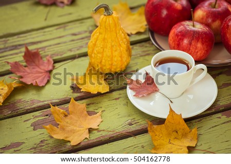 Decorative gourd and tea on a rustic wooden table