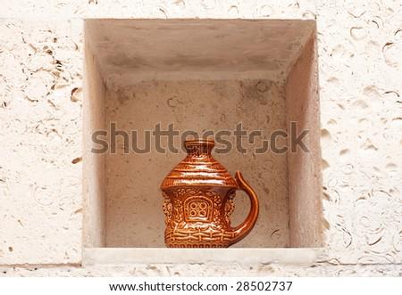 Decorative handmade earthenware in wall niche. Ukrainian culture. - stock photo