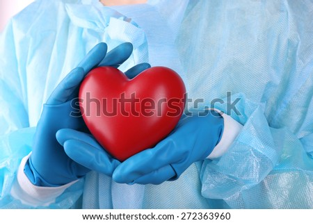 Decorative heart in doctors hands, close-up