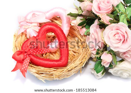 Decorative hearts in nest, isolated on white - stock photo