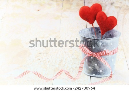 Decorative hearts in retro style on old wood background - stock photo