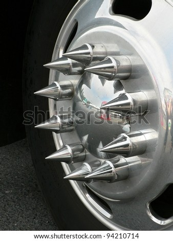 Decorative hubcap on an 18-wheel truck. - stock photo