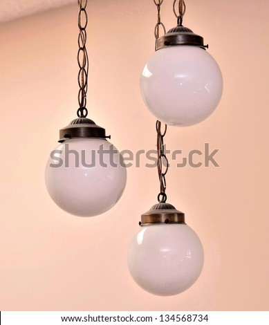 Decorative lamp hangs in the air - stock photo