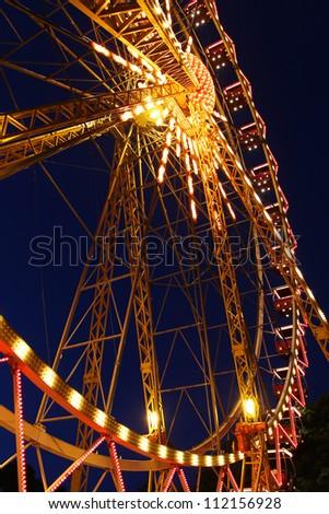 Decorative Lighting Ferris wheel in a city park at night - stock photo