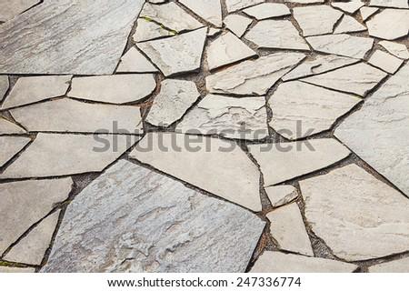 Decorative mosaic pavement texture background close up - stock photo