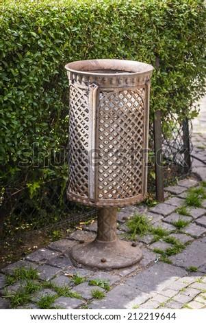 Decorative old iron trash bin in city.Prague. - stock photo
