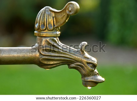 Decorative old vintage brass tap water