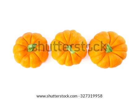 Decorative orange pumpkins, top view isolated on white background