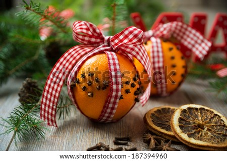 decorative oranges with cloves and ribbons  - stock photo