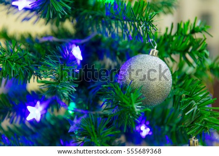 Decorative ornaments and Christmas tree in holiday season.