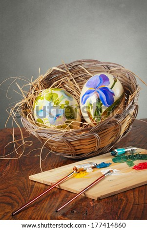 Decorative ostrich eggs with colors and paintbrushes  . Handicraft conceptual - stock photo