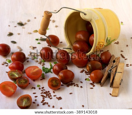 Decorative pail filled with cherry tomatoes