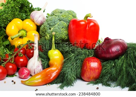 decorative pattern of fresh vegetables on white background