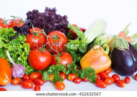 Decorative pattern of fresh vegetables on white background.