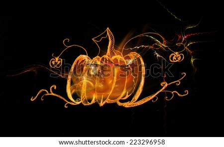 Decorative pattern pumpkin glowing on a black background. Basis drawn in pencil. - stock photo