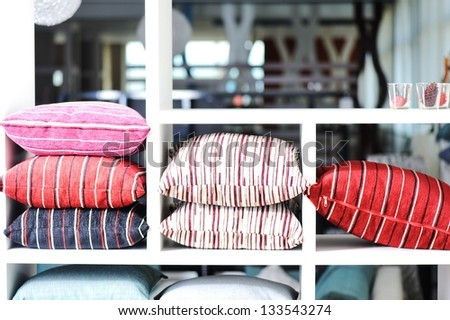 Decorative pillow on shelves - stock photo