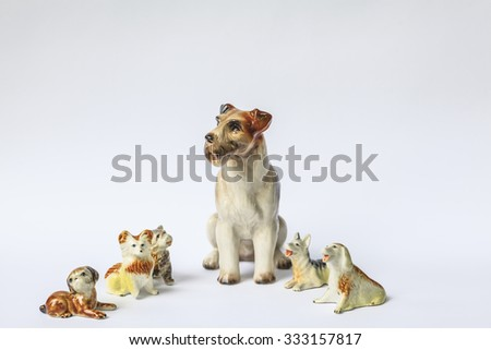 Decorative porcelain dogs isolated on white