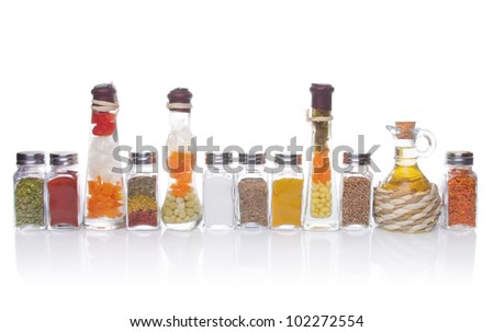 Decorative preserved vegetables and spice on the white background