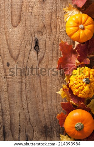 decorative pumpkins and autumn leaves halloween background - stock photo
