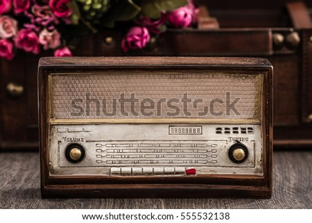 Decorative radio with retro look on brown wooden background