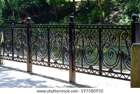 Decorative  railing  in old  stiletto. Metal, wrought. - stock photo