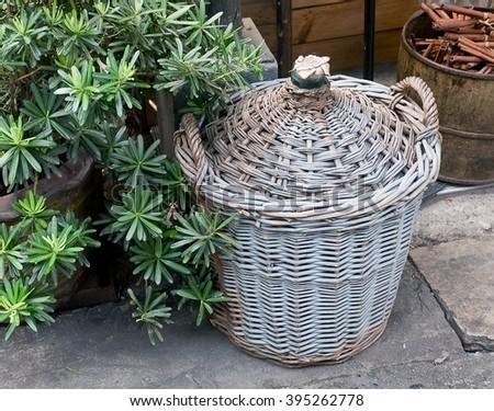 Decorative Rattan Storage Basket for Storage Compartment. - stock photo