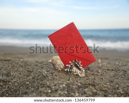 Decorative red  envelope on sand background