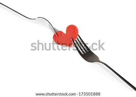 decorative red heart near forks on white background with space for text, concept valentine day dinner