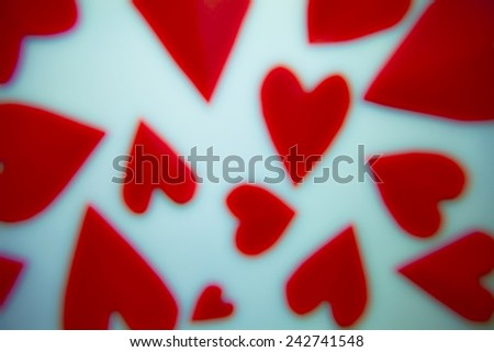 Decorative red hearts on color white background