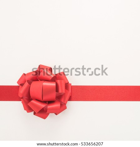 Decorative red ribbon and bow on a white background