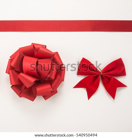 Decorative red ribbon and two bow on a white background