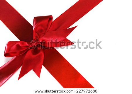 Decorative red satin bow isolated on white background