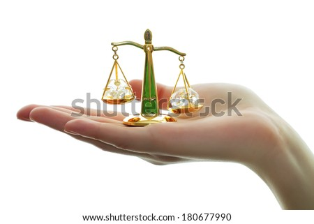 Decorative scales in hand on a white background - stock photo