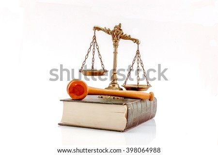 Decorative Scales of Justice and judge gavel on the book, isolated on white. Law and order concept