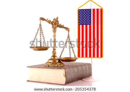 Decorative Scales of Justice, book and American flag on white background - stock photo